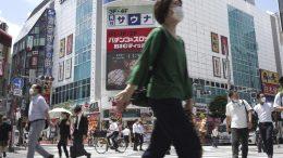 People walking across a crossing in Tokyo